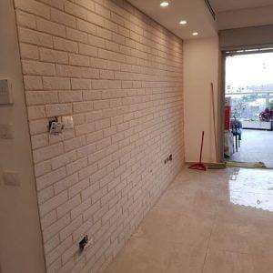 בניית קיר בריקים ביציאה למרפסת