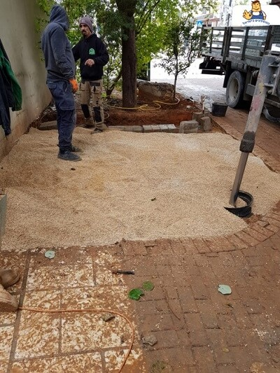 Laying a clay substrate for interlocking stones